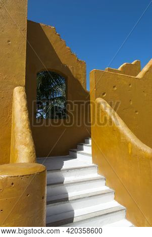 The Replica Of A Fort Wall With Stairs That Surround Tourist Village On Half Moon Cay Island (bahama