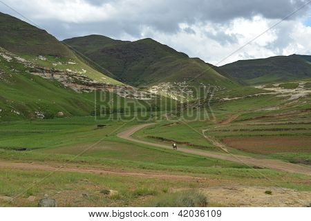 Mounted Sotho Man riding away into Lesotho Landscape poster