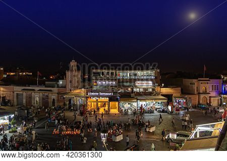 Marrakesh, Morocco - 12 October, 2019: Street Vendors And Tourists In The Jemaa El-fna Square At Nig