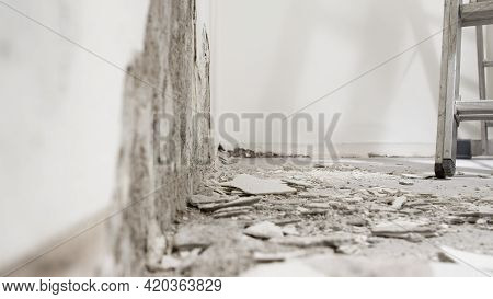 House Renovation Concept, Wall In Demolition With Plaster Rubble And Ladder, White Background With C