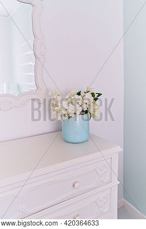 Mirror In Carved Wooden Frame And Vase With Flowers In Light Room, Vintage Interior.