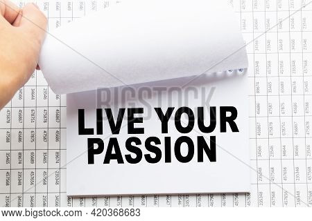 Notepad With Text Live Your Passion On The Office Desk With Stationery. A Blank Notepad For Entering