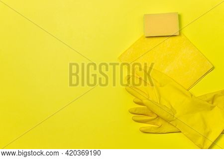 Cleaning Tools On A Yellow Background. Cleanliness Concept. Indoor Washing And Cleaning Tools.