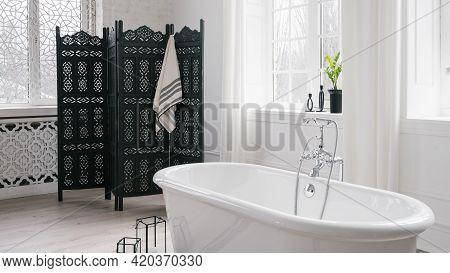 Bathroom With Modern Interior Design, Black Folding Screen, White Freestanding Empty Bathtub, Large