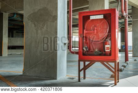 A Red Fire Fighting Equipment Cabinet Or Fire Extinguishing Cabinet Of Fire Protection Set Is Locate