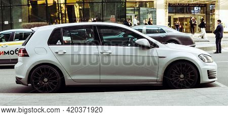 Moscow , Russia - May 2021: Side View Of Volkswagen Golf Gti Parked In Front Of The Shop