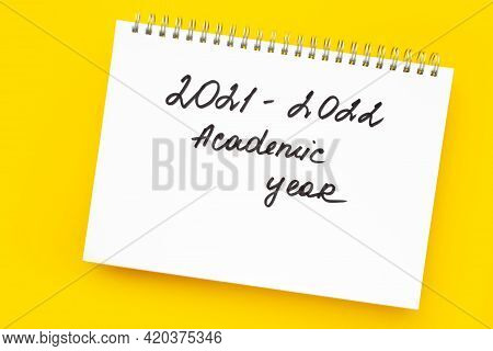 Back To School Concept. Handwriting Inscription In White Notepad, On Vivid Yellow Background. 2021-2