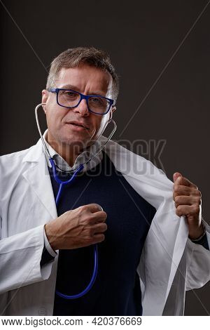 Doctor Or Cardiologist Holding A Stethoscope To His Chest