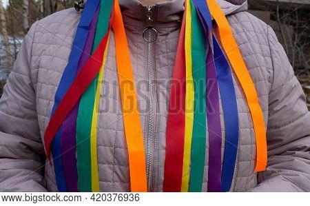 Bright Rainbow Ribbons Hang From Her Shoulders .carnival Ribbons. Lgbt Symbol.