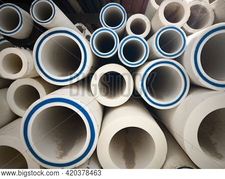 Polypropylene Pipes Stacked At Construction Site. Stack Of Ldpe Water Pipes. Pvc Pipes