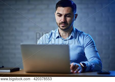 The Company Manager Works On A Laptop. Nearby Is A Notebook, A Handle And A Phone. Management And Pl
