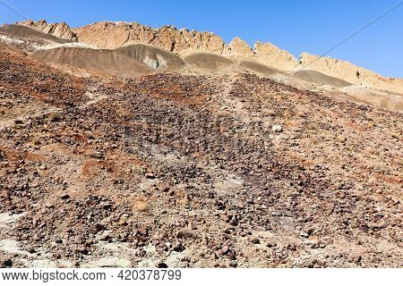 Arid Hillside Covered With Sand And Eroded Rocks On Rural Badlands Taken At The Mojave Desert In The