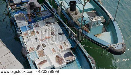 Sai Kung, Hong Kong 30 March 2021: Top down view of fishing boat selling seafood
