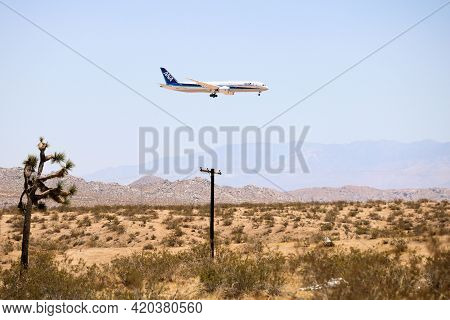 May 12, 2021 In Victorville, Ca:  Ana Airlines Aircraft Landing In The Victorville, Ca Airplane Bone