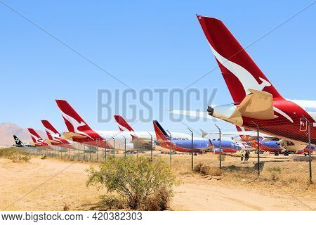 May 12, 2021 In Victorville, Ca:  Stored Airliner Aircraft On An Arid Desert Field Taken At The Vict