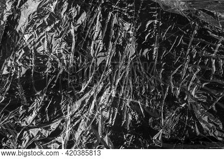 Black Crumpled Wrinkled Plastic Abstract Background