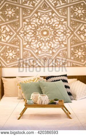 Cozy Interior With A Bed And A Tray With Drinks In Decorated Cups Against The Background Of A Beauti