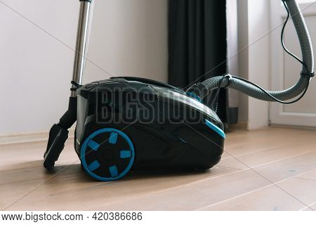 Technologies That Facilitate Wet Cleaning. Modern Household Appliances. Vacuum Cleaner In Folded For