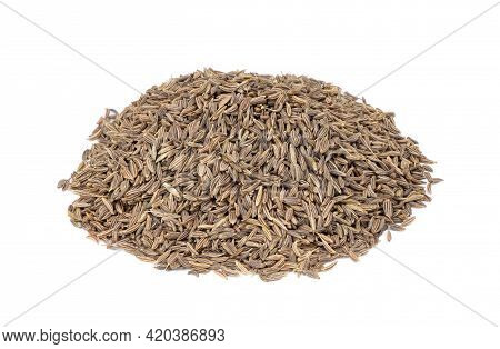 Cumin In A Wooden Spoon Isolated On A White Background. Caraway Seeds. Heap Of Cumin.