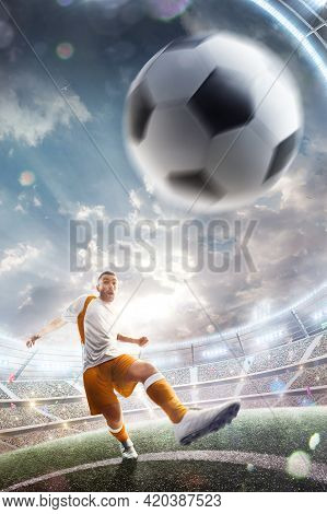 Power Soccer Kick. A Soccer Player Kicks The Ball In Stadium. Professional Soccer Player In Action.