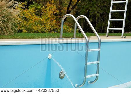 Backyard Swimming Pool With Ladder Emptied Out Shutting Down For Winter