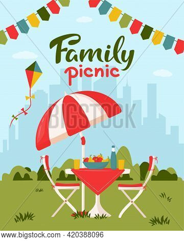 Family Picnic Concept. Outdoor Picnic In A Park. Served Table With Chairs, Kite, Garlands And Umbrel