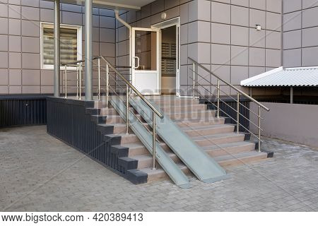 Entrance Group With A Ramp Of A Multi-storey Residential Building. Stairs With Metal Ramp, Apartment