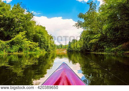 Kayaking Down The River. Calm River Landscape With The Bow Of The Boat In The Foreground. Oskol Rive