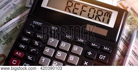Calculator With The Word Reform On Display On Dollar Background