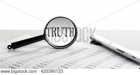 Magnifying Glass With Text Truth On Background With Pen