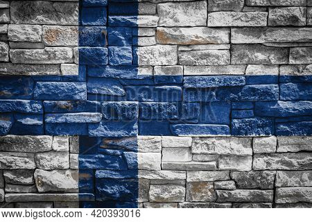 National Flag Of Finland On Stone  Wall Background.the Concept Of National Pride And Symbol Of The C