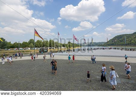 Koblenz, Germany - July 07, 2018: People Walk Along The German Corner, Where The Moselle Flows Into