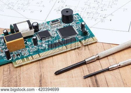 Printed Circuit Board With Transistors, Resistors, Capacitor. Diagram Of Electronics And Precision T