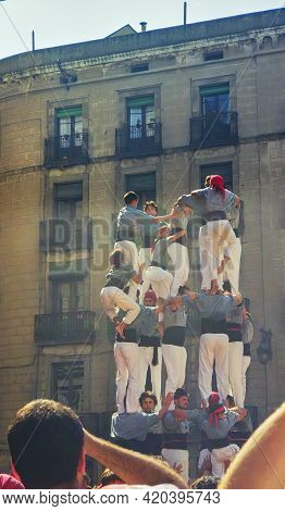 Barcelona, Spain - September 23, 1999: Local People Building Human Towers (castellers), Part Of The