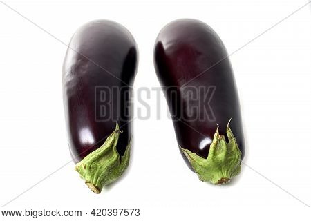 Two Eggplants With Green Sepals Isolated On White Background