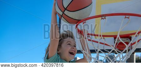 Child Sport Activity. Kids Playing Basketball. Children Lifestyle. Closeup Face Of Kid Basketball Pl