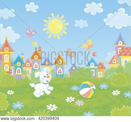 Happy Little Puppy Playing With Merry Colorful Butterflies On Green Grass Of A Sunny Summer Park In