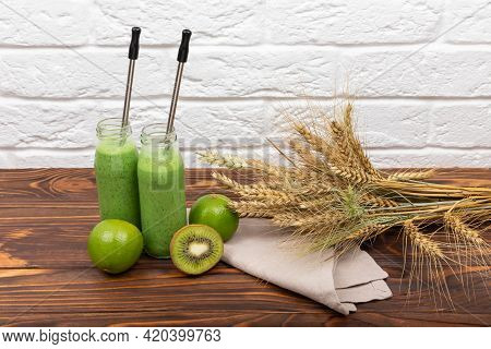 Smoothie Juice On Wooden Table With Cereals. Spinach Milkshake On A Light Background. Fresh Green Sm