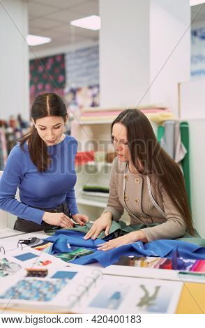 Drapery, Textile Store, Tailor, Atelier Or Dressmaker Concept. Fabrics Shop Assistant Showing Textil
