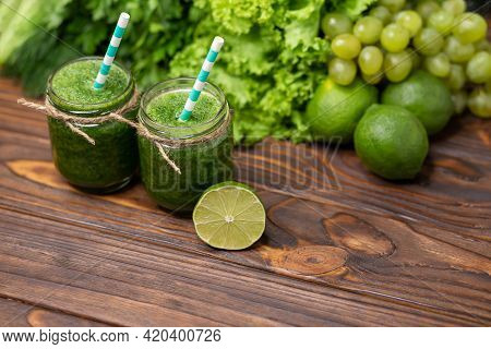 Healthy Green Smoothie With Spinach In A Jar. Detox Diet Concept. Glasses With Green Organic Smoothi
