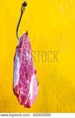 Baited Hook. A Piece Of Meat On A Hook. Raw Meat.