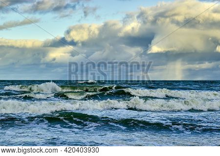 Stormy Sea With Foamy Waves Under Low Floating Amazing Clouds
