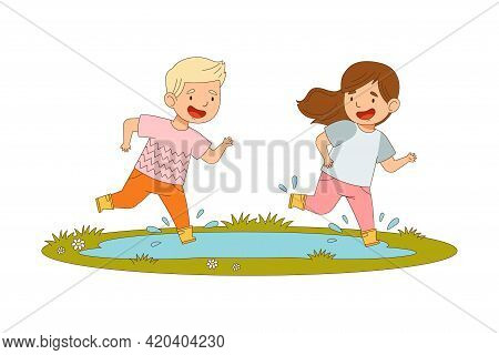 Cheerful Boy And Girl In Yellow Rubber Boots Enjoying Spring Season Splashing In Puddle Vector Illus