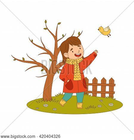 Cheerful Girl In Coat And Rubber Boots Enjoying Spring Season Watching Bird Fluttering Around Vector