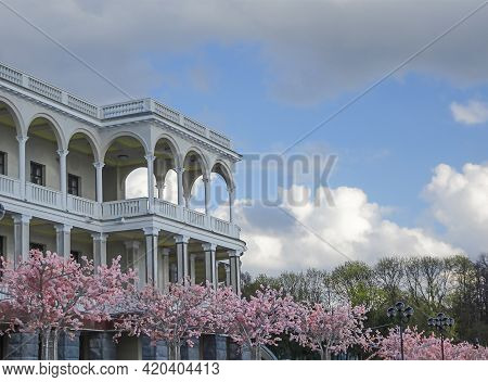 Outside Galleries, Balconies And Colonnades Against The Sky And Flowering Trees, Selective Focus