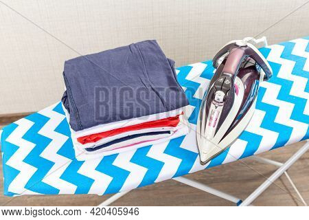 Board With Modern Iron And Shirt At Home. Laundry Day