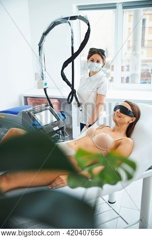Joyous Spa Client Anticipating A Laser Hair Removal Procedure