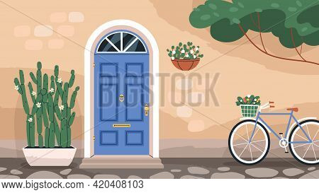 Front Wooden Door With Knocker And Mail Slot. Home Exterior With Arch Doorway And Stone Wall With Pl