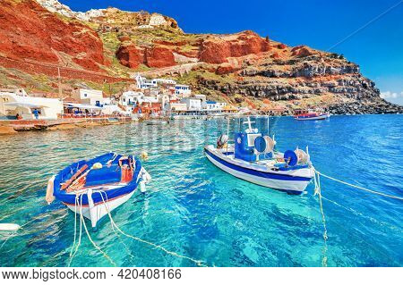Santorini Island With Blue Domes And White Washed House. Magnificent Summer Sunset On Famous Greek R