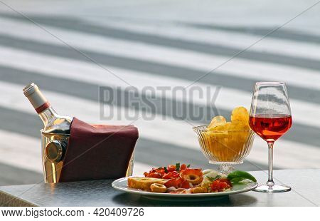 Italian Style Aperitif And Cocktail With Wine, Chips And Cold Cuts